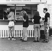 People queuing up for food at a Rock and Blues festival