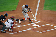 June 14 2011; Phoenix, AZ, USA; San Francisco Giants batter Cody Ross (13) doubles to center during the fourth inning against the Arizona Diamondbacks at Chase Field. Mandatory Credit: Jennifer Stewart-US PRESSWIRE..