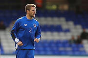 Josh Law of Oldham Athletic warms up before the EFL Cup match between Oldham Athletic and Wigan Athletic at Boundary Park, Oldham, England on 9 August 2016. Photo by Simon Brady.