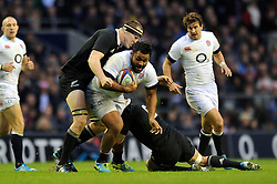 Billy Vunipola (England) is double-tackled in possession - Photo mandatory by-line: Patrick Khachfe/JMP - Tel: Mobile: 07966 386802 16/11/2013 - SPORT - RUGBY UNION -  Twickenham Stadium, London - England v New Zealand - QBE Autumn Internationals.
