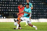 Forest Green Rovers Reuben Reid(26) is tackled by Wycombe Wanderers Curtis Thompson(18) during the 2nd round of the Carabao EFL Cup match between Wycombe Wanderers and Forest Green Rovers at Adams Park, High Wycombe, England on 28 August 2018.