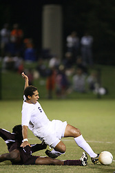 Virginia Cavaliers D/MF Ian Holder (6) in action against Boston College. The Virginia Cavaliers Men's Soccer Team defeated The Boston College Eagles, 3-2 in overtime on September 15, 2006 at Klöckner Stadium in Charlottesville, VA