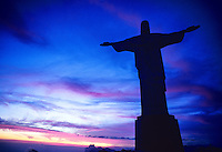 View of Statue of Christ the Redeemer (Cristo Redentor) at sunset, Corcovado Mountain, Rio de Janeiro, Brazil