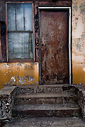"The doorway of an abandoned home where blocks of abandoned homes and small signs of life are all that remain in certain areas of Gary, IN. Gary is part of America's Midwestern ""Rust Belt"", the heartland of the country and home to big unionized manufacturers like the auto and steel industries."