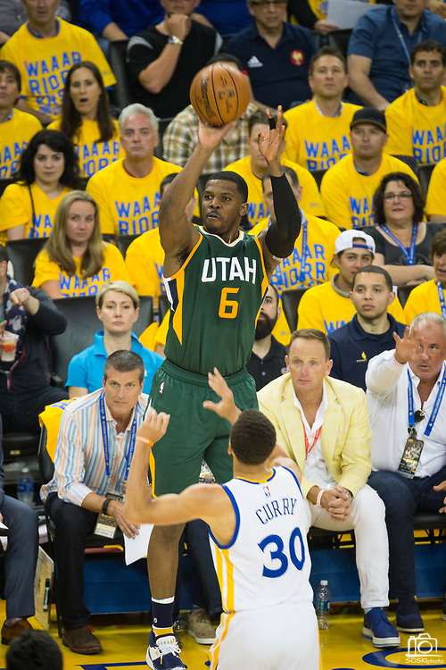 Utah Jazz forward Joe Johnson (6) shoots a jumper over Golden State Warriors guard Stephen Curry (30) during Game 1 of the Western Conference Semifinals at Oracle Arena in Oakland, Calif., on May 2, 2017. (Stan Olszewski/Special to S.F. Examiner)