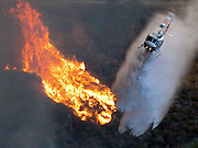 Sep 12, 2006; Castaic, CA, USA; Firefighter helicopter hit a hot spot with water while battling the flames in the Day Fire In Castaic, Calif. Sept. 12, 2006. Firefighters are still battling a huge wildfire north of Los Angeles today, that has charred about 39 square miles, in an attempt to prevent it crossing Interstate Five (I 5), one of California's busiest freeways. Fire officials are concerned it could head towards a mobile home park but so far there have been no major injuries. <br /> ©ZP/Exclusivepix