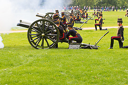 Hyde Park, London, June 2nd 2016. Soldiers and guns of the King's Troop Royal Horse Artillery fire a 41 round Royal Salute to mark the 63rd anniversary of the coronation of Britain's Monarch HM Queen Elizabeth II. PICTURED: A gun spews fame as it fires. PICTURED: Smoke from the guns drifts across the park.