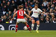 Kit Graham dribbles at Lia Walti during the FA Women's Super League match between Tottenham Hotspur Women and Arsenal Women FC at Tottenham Hotspur Stadium, London, United Kingdom on 17 November 2019.