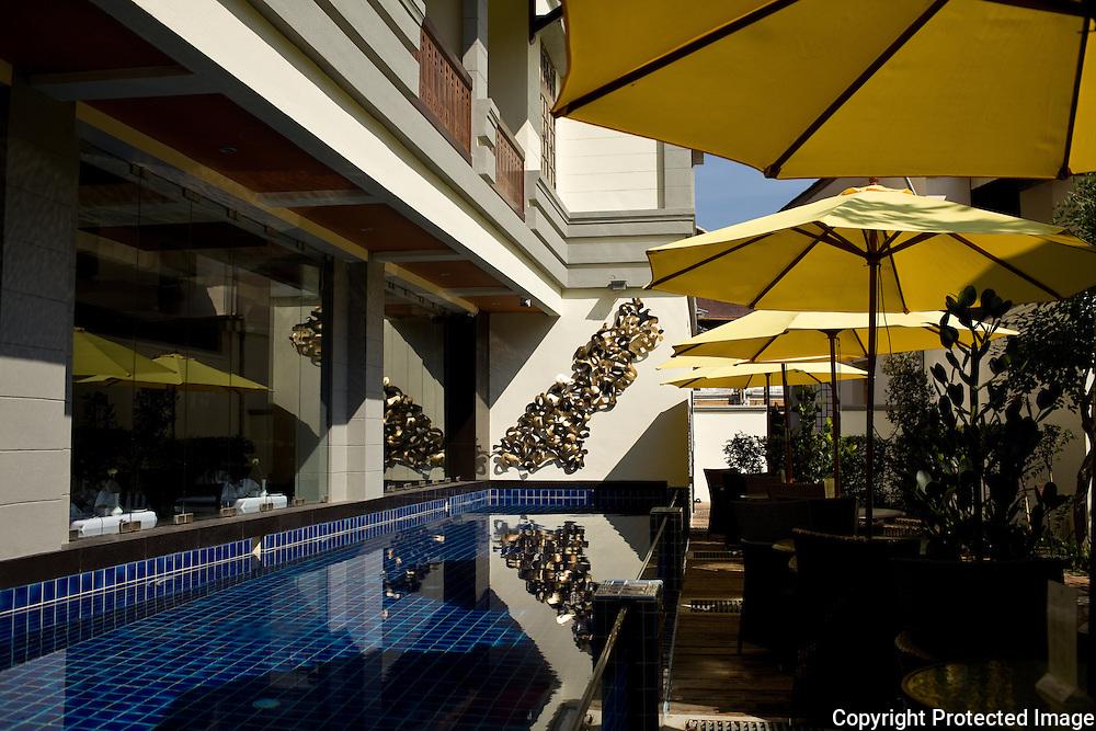 swimming pool and garden area of Penaga Hotel