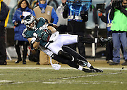 Philadelphia Eagles wide receiver Riley Cooper (14) gets tackled after catching a fourth quarter pass during the NFL NFC Wild Card football game against the New Orleans Saints on Saturday, Jan. 4, 2014 in Philadelphia. The Saints won the game 26-24. ©Paul Anthony Spinelli