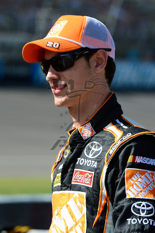 Brooklyn, MI  - Aug 17, 2012: Joey Logano (20) stands on pit row during qualifying for the Pure Michigan 400 at Michigan International Speedway in Brooklyn, MI.