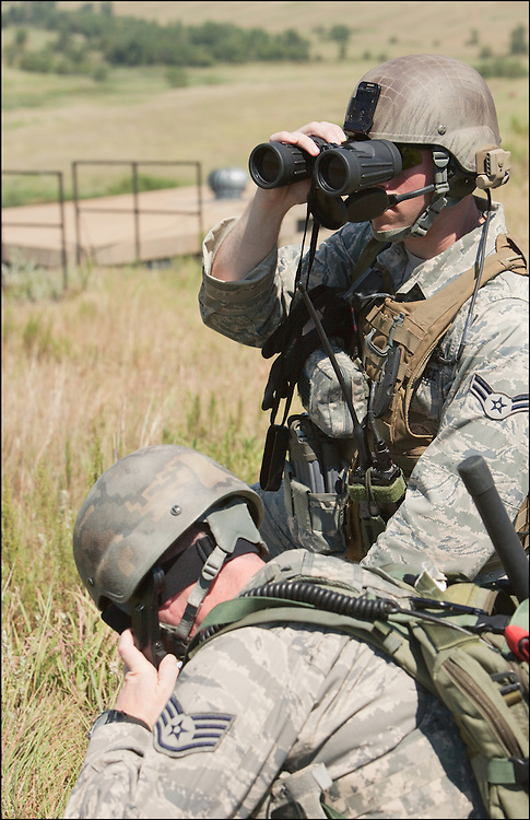 Binoculars help these troops to spot out potential enemies during their training at the Smokey Hill Air National Guard Range.