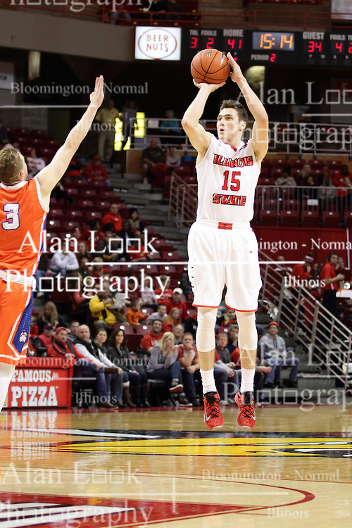 21 November 2015: Asa Cantwell(3) doesn't have a chance to thwart this three point shot by Justin McCloud(15). Illinois State Redbirds host the Houston Baptist Huskies at Redbird Arena in Normal Illinois (Photo by Alan Look)