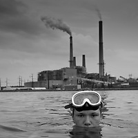USA, West Virginia, Mount Storm, Young boy swimming in Mount Storm Lake heated by effluent from Mount Storm Power Station