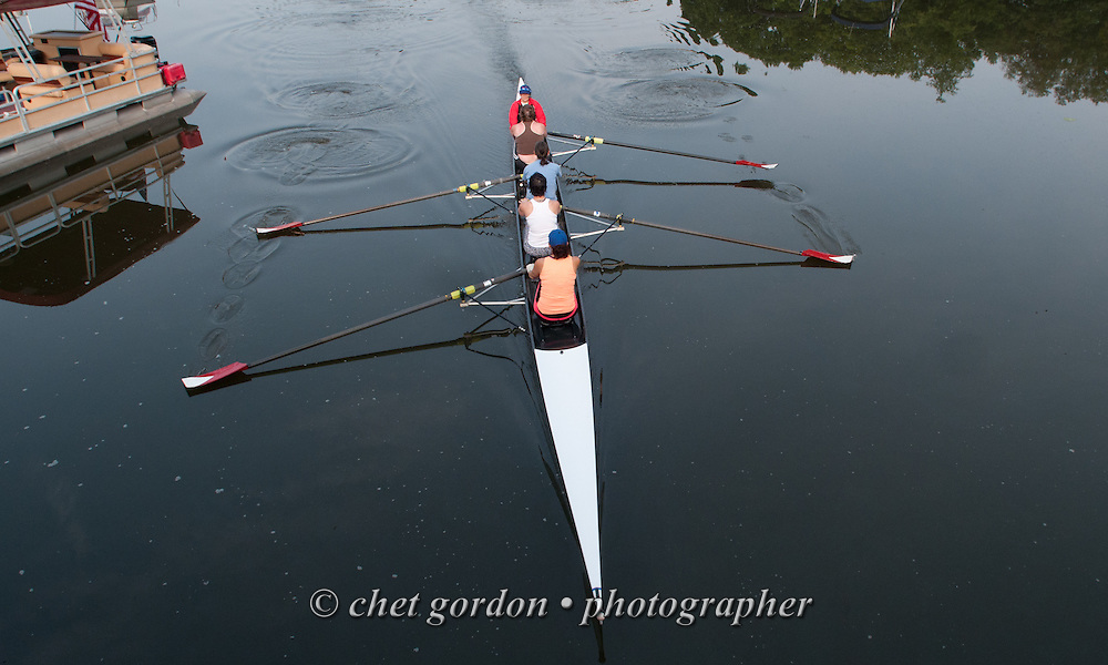 GREENWOOD LAKE, NY.  A woman's crew team row under a bridge during their early morning row in Greenwood Lake, NY on Monday, July 6, 2015.  © Chet Gordon/THE IMAGE WORKS