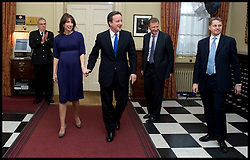 Cabinet Secretary Sir Gus O'Donnell (2nd right) and Jeremy Heywood (right, light blue tie), Permanent Secretary at No. 10 greet The Prime Minister David Cameron as he and his wife Samantha arrive inside  No10 as the new PM, Tuesday May 11, 2010. .The  Cabinet Secretary Sir Gus O'Donnell steps down at the end of the year and is replaced by Jeremy Heywood (left), currently Permanent Secretary at No. 10, will replace Gus O'Donnell as Cabinet Secretary. Photo By Andrew Parsons/ i-Images