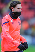 Blackburn Rovers forward Ben Brereton (20) protects himself from the cold weather as he warms up prior to the EFL Sky Bet Championship match between Charlton Athletic and Blackburn Rovers at The Valley, London, England on 15 February 2020.