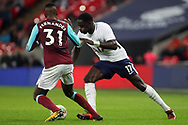 Moussa Sissoko of Tottenham Hotspur (R) takes on Edimilson Fernandes of West Ham United (L). EFL Carabao Cup, 4th round match, Tottenham Hotspur v West Ham United at Wembley Stadium in London on Wednesday 25th October 2017.<br /> pic by Steffan Bowen, Andrew Orchard sports photography.