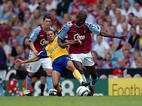 Photo: Richard Lane.Digitalsport<br /> Aston Villa v Southampton. Barclays Premiership. 14/08/2004.<br /> Carlton Cole (rt) and  Fabrice Fernandes battle for the ball.