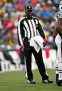 An NFL official wears a pink whistle and pink wrist bands for Breast Cancer Awareness at the Buffalo Bills NFL week 4 football game against the New York Jets on Sunday, October 3, 2010 in Orchard Park, New York. The Jets won the game 38-14. (©Paul Anthony Spinelli)
