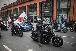 """© Licensed to London News Pictures. 12/04/2019. London, UK. Thousands of bikers make their way through Kensington in West London to take part in a protest against the prosecution of a former British soldier charged over Bloody Sunday.  The ride-out is being staged in support of """"Soldier F"""", a 77-year-old Army veteran who faces charges of murder after killing two civil rights demonstrators in Londonderry, Northern Ireland, in 1972. Photo credit: Ben Cawthra/LNP"""