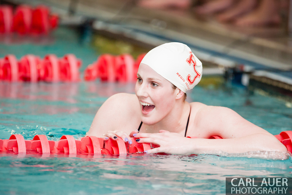 January 8, 2013: Olympic Gold Medalist and Regis Jesuit High School senior Missy Franklin cheers on her teammates in her return to the pool after the London Olympics during the swim meet against Highlands Ranch at Regis Jesuit High School.