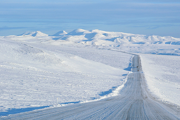 Ian Stewart/Yukon News<br /> Trucks head north on the NWT side of the Dempster Highway in the Richardson Mountain Range. <br /> <br />  &copy; 2013 IAN STEWART PHOTOGRAPHY