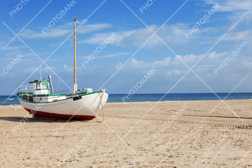 Fishing boats stranded on the beach at low tide