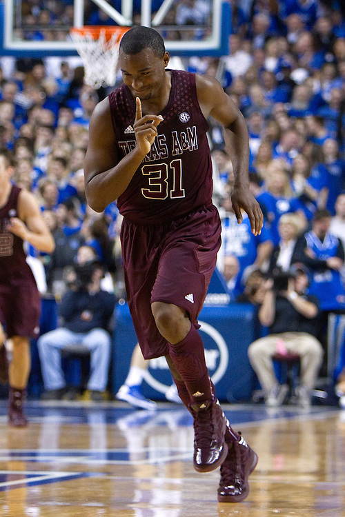 Texas A&M guard Elston Turner celebrates a three point basket in the first half. Turner scored 40 points against UK and his team won, 83-71. The University of Kentucky Men's Basketball team hosted Texas A&M , Saturday, Jan. 12, 2013 at Rupp Arena in Lexington . Photo by Jonathan Palmer/Special to the Courier-Journal.
