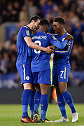 Leicester City midfielder Vicente Iborra (21) and Leicester City midfielder Demarai Gray (7) congratulate Leicester City forward Kelechi Iheanacho (8) after scoring a goal to make it 1-1 during the EFL Cup match between Leicester City and Leeds United at the King Power Stadium, Leicester, England on 24 October 2017. Photo by Jon Hobley.