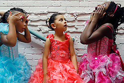 Contestants Jaielle Lawson (left), Nicole Urrutia (center), Maya Ogbogu (left) pass the time during the Miss Inner-Beauty Pageant at the Plano Courtyard Theater.
