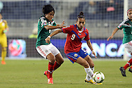 16 October 2014: Carolina Venegas (CRC) (9) and Liliana Mercado (MEX). The Mexico Women's National Team played the Costa Rica Women's National Team at Sporting Park in Kansas City, Kansas in a 2014 CONCACAF Women's Championship Group B game, which serves as a qualifying tournament for the 2015 FIFA Women's World Cup in Canada. Costa Rica won the game 1-0.