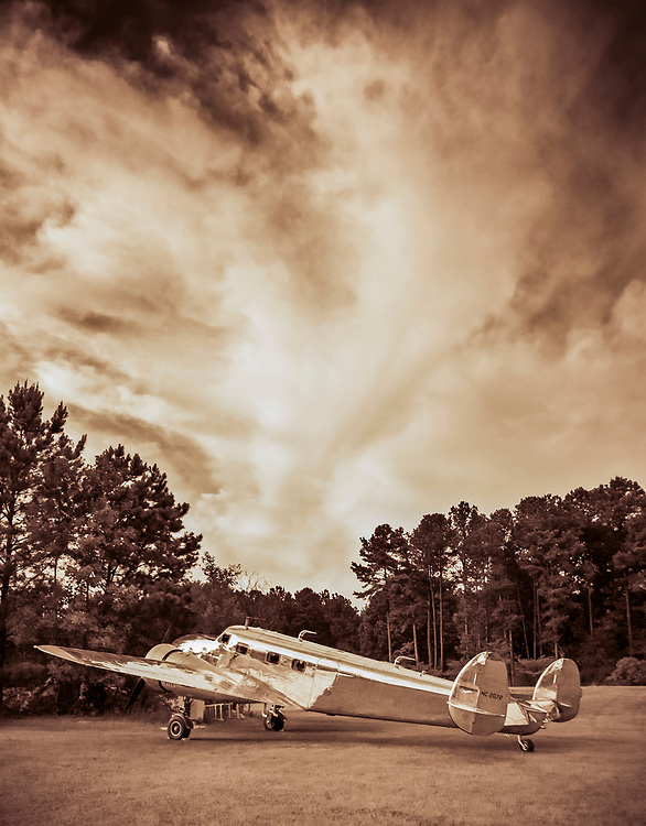 Restored Lockheed 12A Electra Junior...under a summer sky.  Fayetteville, Georgia.