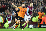 Aston Villa midfielder Birkir Bjarnason (20) passes under pressure from Wolverhampton Wanderers striker (on loan from Al-Hilal) Leo Bonatini (33) during the EFL Sky Bet Championship match between Aston Villa and Wolverhampton Wanderers at Villa Park, Birmingham, England on 10 March 2018. Picture by Dennis Goodwin.