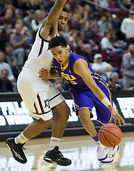 LSU guard Tremont Waters (3) drives the lane against Texas A&M guard TJ Starks (2) during the second half of an NCAA college basketball game Saturday, Jan. 6, 2018, in College Station, Texas. (AP Photo/Sam Craft)