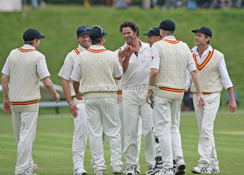 27/04/2008. Cricket. Tour Match. MCC v New Zealand. MCC Captain and former New Zealand all rounder Chris Cairns celebrates taking Jamie How's wicket with his team mates. Arundel, Sussex, UK. ©Offside/Steve Bardens.