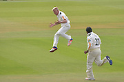 Luke Wood celebrated the wicket of Jimmy Adams (not shown) chased by Samit Patel during the Specsavers County Champ Div 1 match between Nottinghamshire County Cricket Club and Hampshire County Cricket Club at Trent Bridge, West Bridgford, United Kingdom on 13 August 2016. Photo by Simon Trafford.