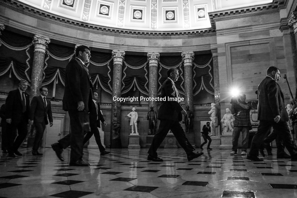 U.S. House Speaker John Boehner (R-OH) walks to the House floor for a vote on fiscal legislation to end the government shudown, at the U.S. Capitol in Washington, October 16, 2013. The U.S. Senate prepared for a last ditch effort Wednesday to avoid a historic lapse in the government's borrowing authority, a breach that President Barack Obama has said could lead to default and deliver a damaging blow to the global economy.