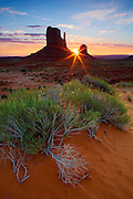 The break over the horizon between the  Mittens at sunrise. Monument Valley, Arizona.