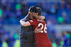 CARDIFF, WALES - Saturday, April 20, 2019: Liverpool's manager Jürgen Klopp celebrates with Andy Robertson after the 2-0 victory during the FA Premier League match between Cardiff City FC and Liverpool FC at the Cardiff City Stadium. (Pic by David Rawcliffe/Propaganda)