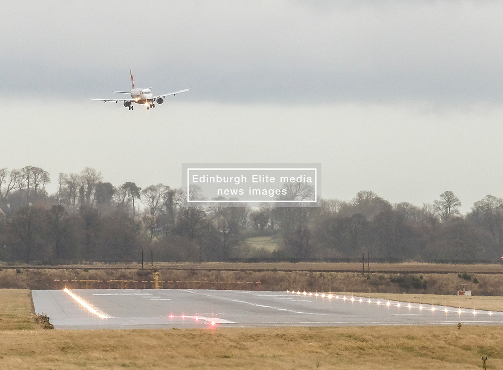 High Winds at Edinburgh Airport, Tuesday 7th January 2020<br /> <br /> Planes struggled on landing and take-off as high winds hit Edinburgh Airport today<br /> <br /> Pictured: A British Airways flight struggles to stay level as it comes in to land<br /> <br /> Alex Todd | Edinburgh Elite media
