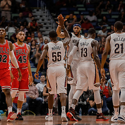 Oct 3, 2017; New Orleans, LA, USA; New Orleans Pelicans guard E'Twaun Moore (55) celebrates with forward Anthony Davis (23) after scoring at the end of the first quarter of a NBA preseason game against the Chicago Bulls at the Smoothie King Center. Mandatory Credit: Derick E. Hingle-USA TODAY Sports