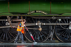 © Licensed to London News Pictures. 26/04/2018. York UK. A York Rail Museum cleaner works in front of the Flying Scotsman ahead of a photo call at York Rail Museum this morning with the UK's first Hyperloop pod. The revolutionary Hyperloop technology could see passenger pods travelling inside near-vacuum tubes at speeds of up to 650 mph and could theoretically reduce York to London journey times to just 20 minutes. The Hyperloop pod is at the museum to launch the museum's new visual identity & to mark the occasion bought together the past, present & future of rail travel. Photo credit: Andrew McCaren/LNP