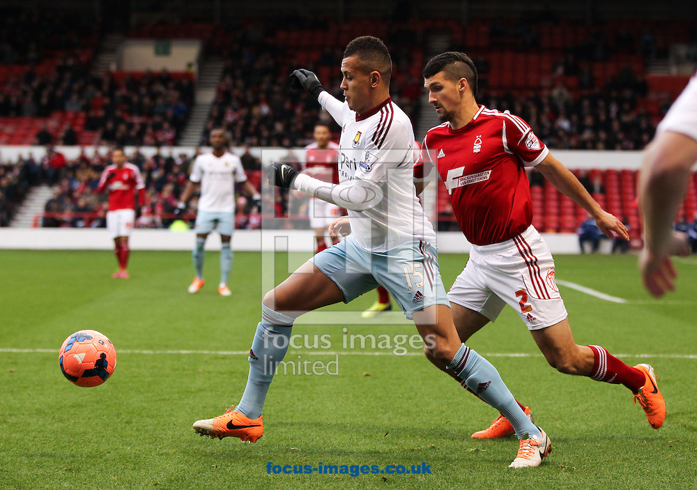 Picture by Tom Smith/Focus Images Ltd 07545141164<br /> 05/01/2014<br /> Eric Lichaj (right) of Nottingham Forest puts Ravel Morrison (left) of West Ham United under pressure during the The FA Cup match at the City Ground, Nottingham.