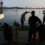 Golfers take aim at a private club in Hanoi, Vietnam. As Vietnam's cities grow more affluent, nouveau-riche are taking up yoga and golf, replacing activities like tai chi and badminton.
