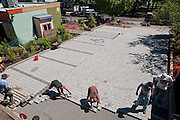 Volunteer work party laying pavers for the pervious pavement parking lot paving work meet (L-R): Charles Heying, Rick Wasserloos, Fred Davis, Josh Lighthipe, Adam Zucker.  Café au Play at Tabor Commons, a project of the Southeast Uplift Neighborhood Coalition (SEUL) and volunteers from Portland's Mt Tabor neighborhood.