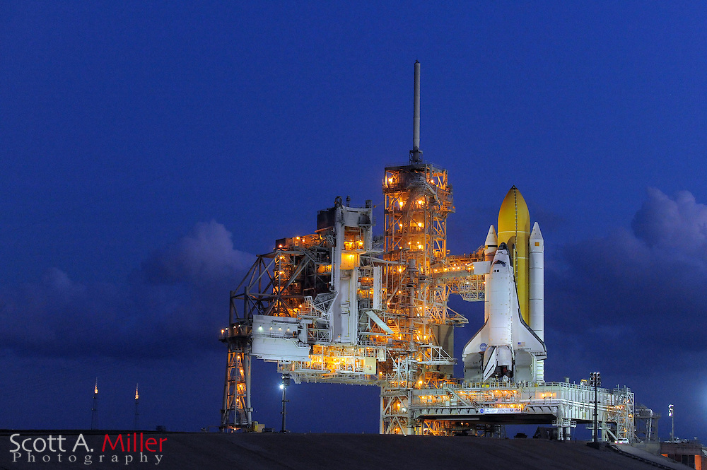 "Cape Canaveral, Florida, Sept 21, 2010; Space Shuttle Discovery sits on Launch Pad 39A for it's planned Nov. 1, 2010 launch from Cape Canaveral..Discovery has flown 38 flights, completed 5,247 orbits, and has spent 322 days in orbit. Discovery is the orbiter fleet leader, having flown more flights than any other orbiter in the fleet, including four in 1985 alone. Discovery flew all three ""return to flight"" missions after the Challenger and Columbia disasters: STS-26 in 1988, STS-114 in 2005, and STS-121 in 2006...©2010 Scott A. Miller"