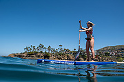 Caitlin Looby @caitlooby paddling offshore of Laguna Beach, CA.