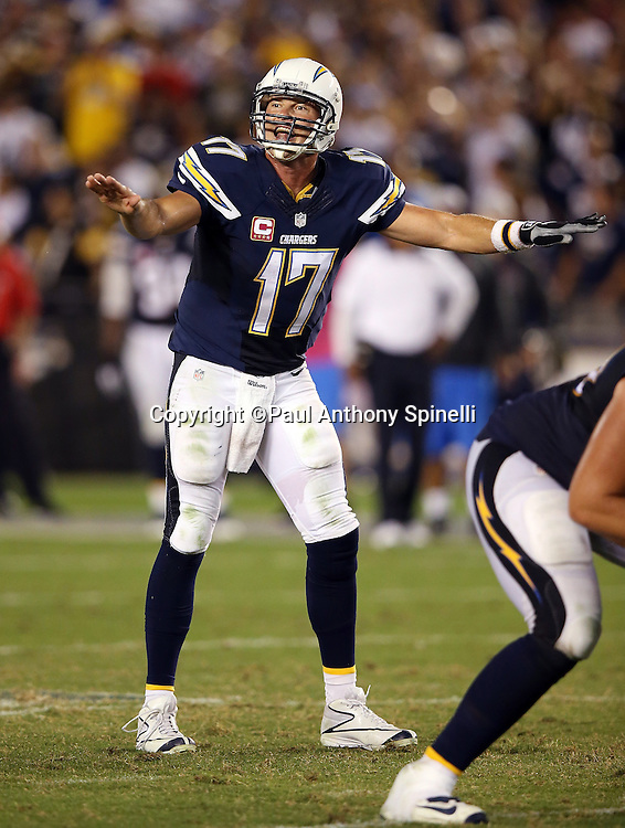 San Diego Chargers quarterback Philip Rivers (17) waves his arms as he calls signals during the 2015 NFL week 5 regular season football game against the Pittsburgh Steelers on Monday, Oct. 12, 2015 in San Diego. The Steelers won the game 24-20. (©Paul Anthony Spinelli)