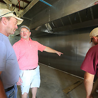 Darren Stafford, center, discusses where he needs the kitchen applainces to be located as they get closer to opening the new Brick and Spoon on North Gloster.